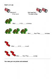 English worksheet: IS or ARE