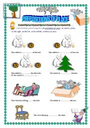English Worksheet: describing pictures using the prepositions of place .