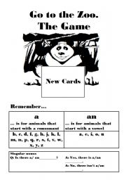 English Worksheet: Go to the Zoo, a Go Fish type card game using articles.