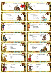 English Worksheets: Scooby-doo cards multiple choice with Present simple & continuous