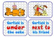 English Worksheet: Prepositions Flascards with Garfield the cat